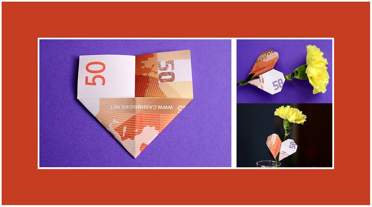 Geldscheine falten Herz zum Valentinstag
